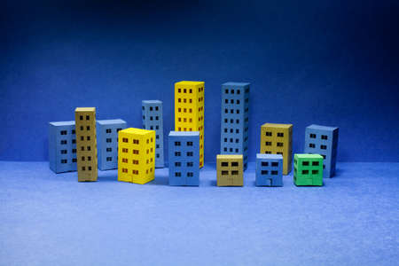 Abstract city architecture landscape, simplified town layout with different buildings, skyscrapers many windows. Blue background, evening time. Imagens