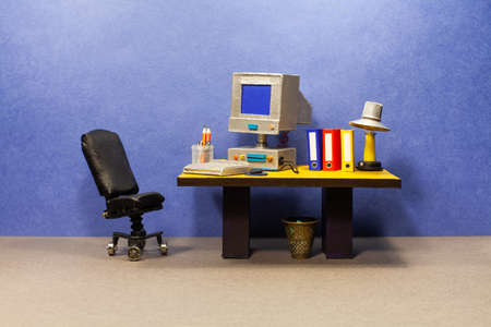 Retro style office workplace. Vintage toy computer, empty blue screen monitor, pc mouse keyboard, archive files. Desk lamp. Comfortable black leather manager chair