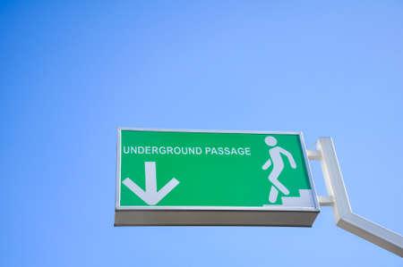 Green underground passage signpost