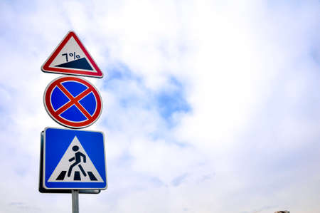 Road sign indicating pedestrian cross and no parking Stock Photo