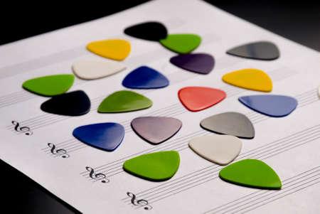Guitar picks on a blank music sheet