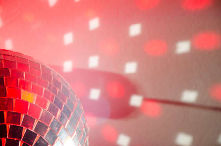 Disco ball in red light