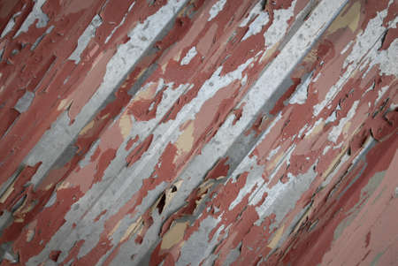 Peeling paint. Metal fence with paint splashes. Stock Photo