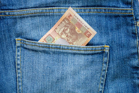Hryvnia, the note of hryvnia in a jeans pocket of two hryvnias.