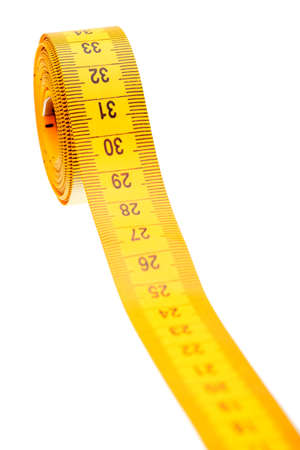 Santimert for measurement of the sizes and volumes of yellow color on a white background, nobody.