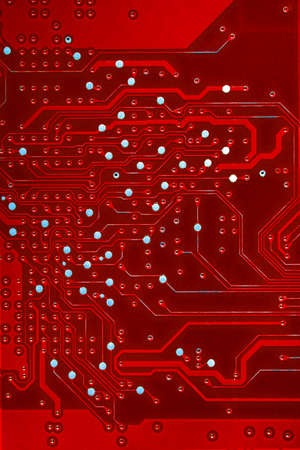 printed circuit: Detail of an electronic printed circuit board a red color.
