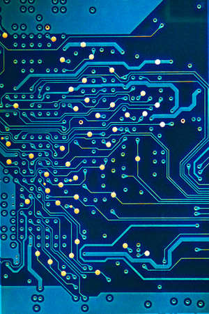 printed circuit: Detail of an electronic printed circuit board a blue color. Stock Photo