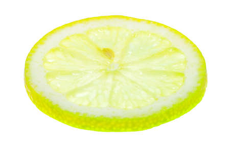 Ringlet of the cut-off fresh lemon on a white background, light from below full sharpness. Stock Photo