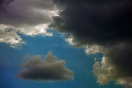 Storm clouds light and dark before a rain. Stock Photo