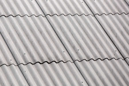 roofing felt asbestos, overlapping roof close up. Stock Photo