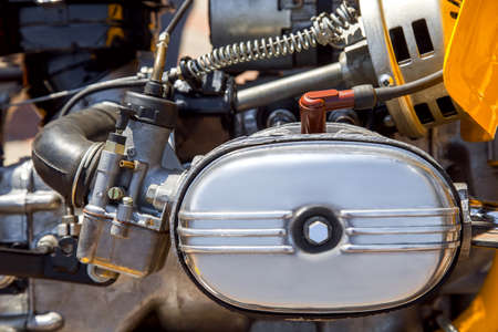 carburetor: Opposite carburetor engine of the motorcycle, old motor of the motorcycle close up. Stock Photo