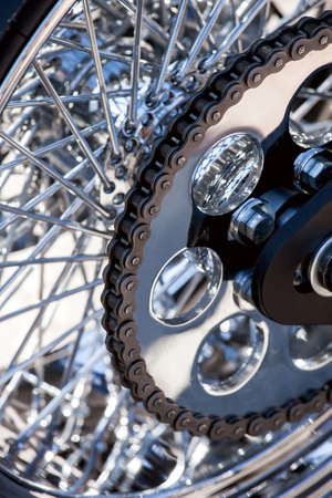 motorcycle chain on a back wheel with chromic spokes, deteil motocycle part.