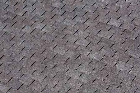 Bardeaux de toiture couleur noir et gris, texture tuile de toit.