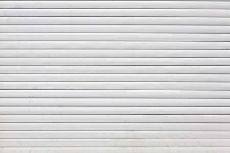 shutter: rolling shutter, close up texture striped gate of white color.