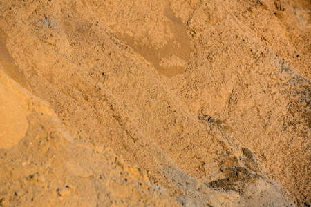 sand quarry: Sand close up, the mountain of yellow sand filled on a heap. Stock Photo
