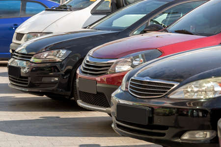 The cars built in a row stand on the parking, car became covered with dust. Stock Photo