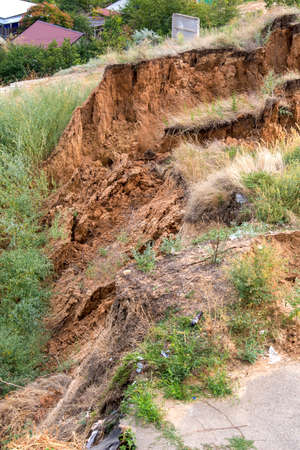 Soil landslide on slopes after degradation of the soil rain or underground water and an earthquake.