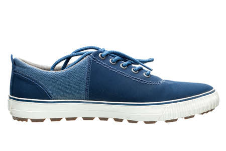 Gym shoes, sports shoes from blue fabric and a white rubber sole, the isolated subject. Stock Photo