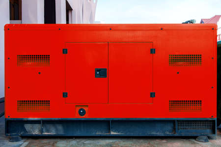 Mobile electric power generator for emergency situations, red color on outdoor.