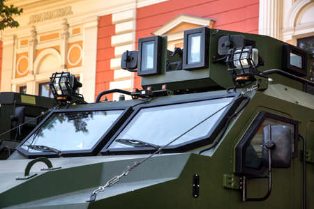 Close up of the windshield of an armored military vehicle with equipment for reconnaissance of the Ukrainian army in the city.