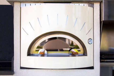 Oven for making pizza light beige in retro style with a temperature sensor with an arrow.