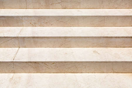 Marble staircase with stone beige steps close up detail of architecture lit by sunlight. Reklamní fotografie