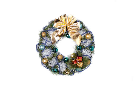 Christmas wreath with a golden bow and Christmas balls and balls of gray and blue color isolated on a white background.