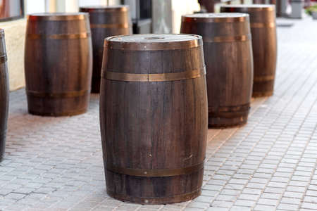 brown wooden barrel on the city street on stone tile, row decorations close up nobody. Stock fotó