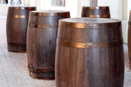 brown wooden barrel on outdoor on stone gray tile, bar decorations close up nobody.