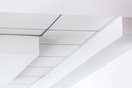 multi-level ceiling with three-dimensional protrusions and a suspended tiled ceiling, perspective on the ceiling.