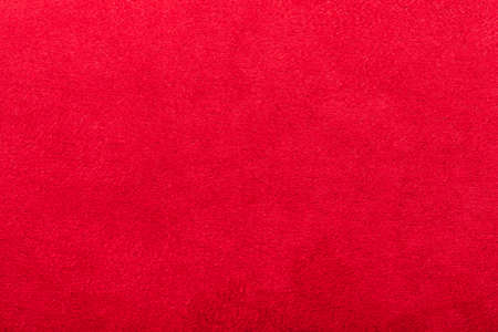 red suede texture, close up of textile material with copy space.