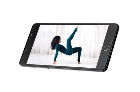 remote online yoga class gadget broadcasting communication of the trainer with quarantined people sitting at home on the phone, telephone isolated on white with a woman on the screen. 版權商用圖片
