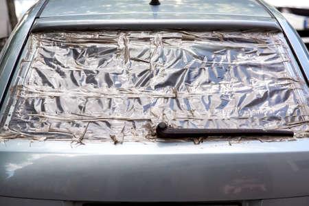 broken rear window of the car adhesive tape, damaged window insurance case.