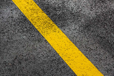 yellow markings of the new highway with tarmak road surface close up asphalt texture, nobody.