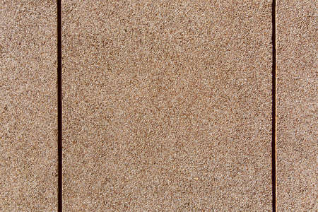 wall texture with a granular coating of moisture resistant tar, a close-up of a building facade with copy space, nobody.