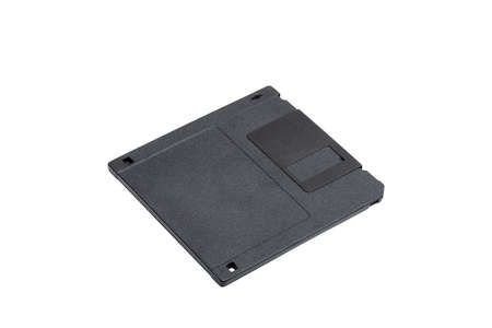 floppy disk in a black square plastic label case with copy space, obsolete computer technology device memory carrier 80s isolated on white background, nobody.