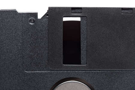 floppy diskette in a black square plastic case with open magnetic disk, obsolete computer technology device memory carrier 90s isolated on white background, close up view, nobody.