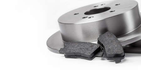 set of brake pads with brake disc new car spare parts brake shoe for a vehicle isolated on a white background banner with copy space, nobody.