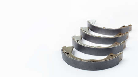 brake shoes for drum brakes, spare parts for car consumables for service and maintenance of vehicle isolated objects on a white background with copy space banner, nobody.