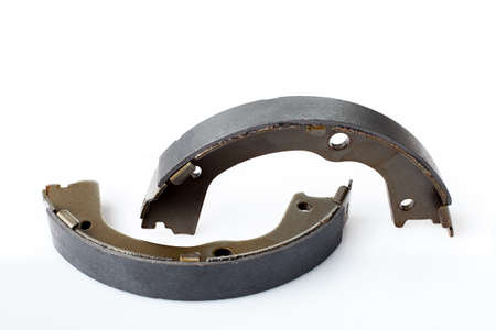 kit of drum brake pads with asbestos alloy on steel car spare parts, view hand brakes isolated on white background.
