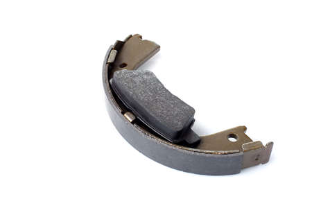 two kinds asbestos brake pads for disc and brake shoe for drum brakes, replacement spare parts of the car brake system isolated on white background, nobody.