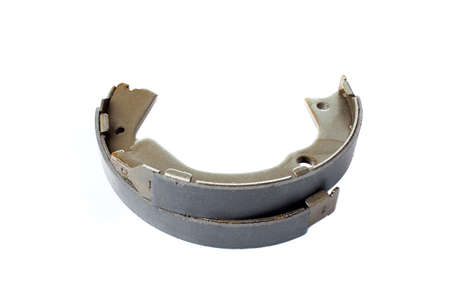 set of brake pads asbestos alloy vehicle spare parts, drum shoe pads isolated on white background, nobody.