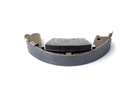 set of asbestos brake pads and brake shoe for disc and drum brakes, replacement spare parts of the car brake system isolated on white background, nobody.