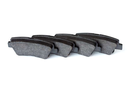 kit of brake pads asbestos alloy car spare parts objects isolated on a white background, nobody.