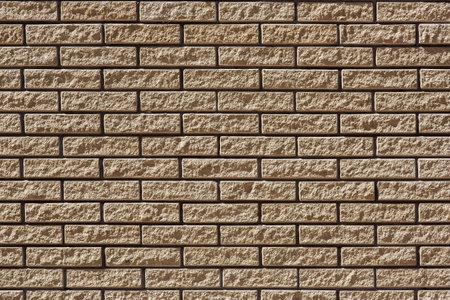 brick facade of beige wall, stone building texture, closeup nobody.