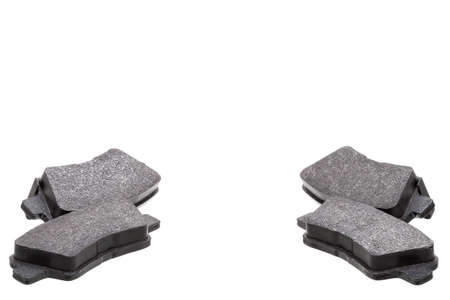 a pair of brake pads car spare parts, vehicle objects kit of brake shoes isolated on white background, nobody.