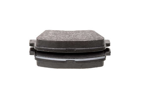 brake pads car spare parts, vehicle brakes object lies one on top of the other isolated on white background, nobody.