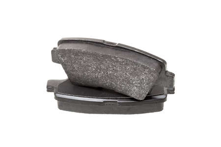 brake pads one on top of the other demonstrate the thickness of asbestos abrasive coating, new car spare parts isolated on white background. Stock fotó