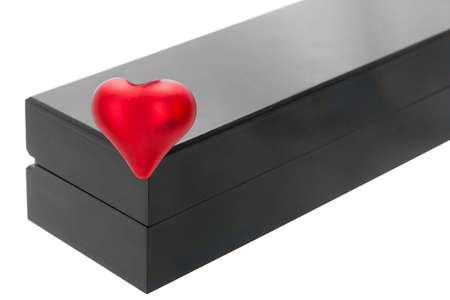 red heart on the corner of a black wooden label box for gifts for valentine's day, holidays objects isolated on white background with copy space.