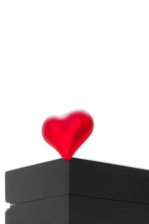 red heart of love and devotion on a black wooden gift box, poster Valentine's Day backdrop with decor objects isolated on white background with copy space, nobody. Stock fotó